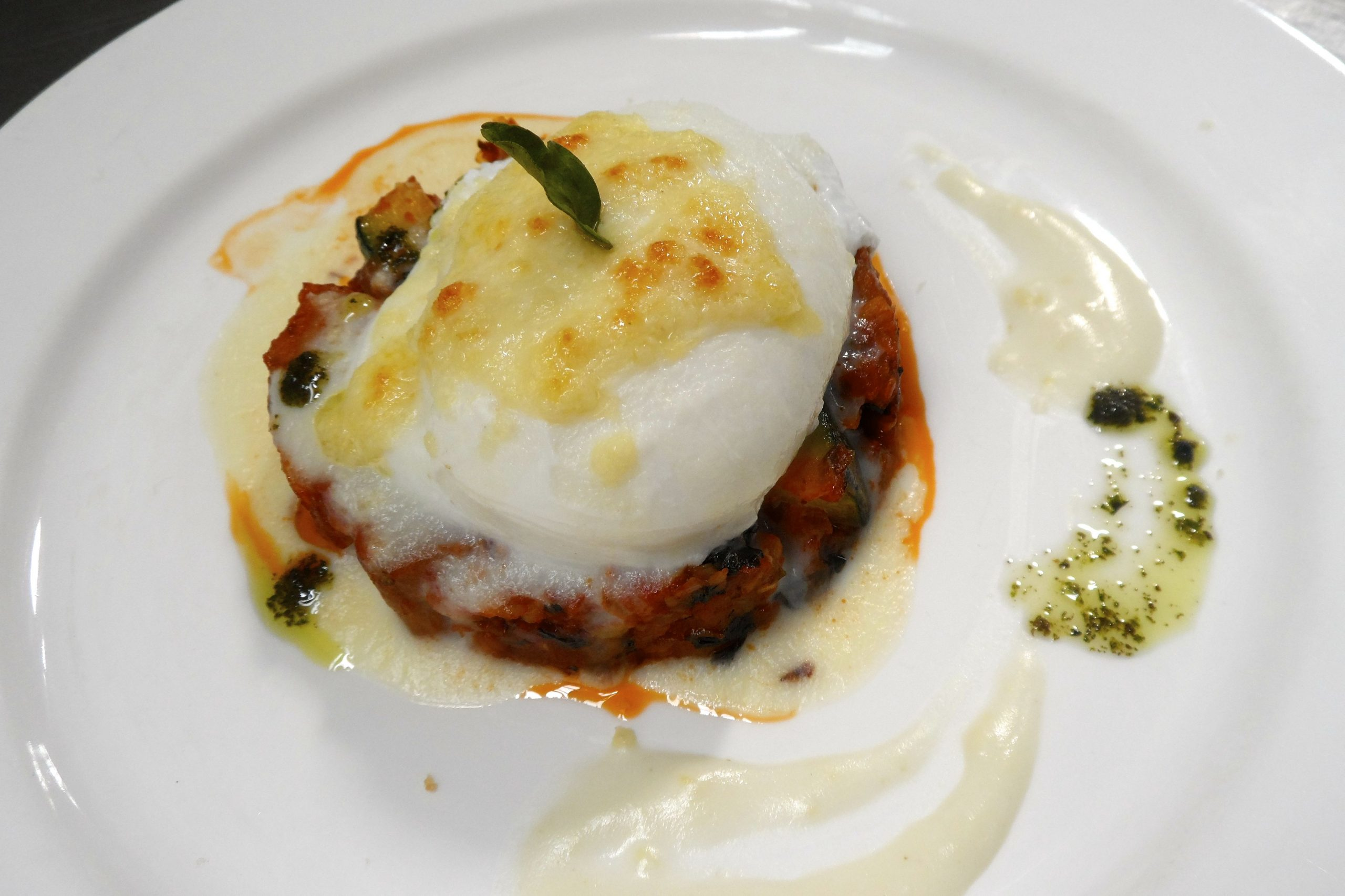 Poached on ratatouille with Mornay sauce2